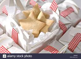 where to buy boxes for presents shaped cut out biscuits being packed in simple plain white