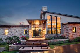contemporary courtyard style home with texas hill country views