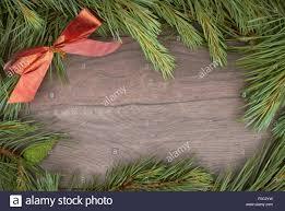 traditional pine tree christmas border decoration on a wood stock
