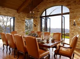 dining room design stacked stone wall and vaulted ceiling in