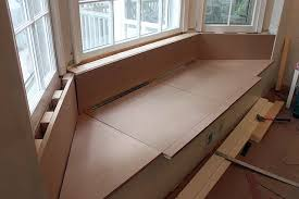 building a window seat with storage in a bay window pretty handy