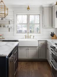 cabinet trim kitchen sink light gray shaker cabinets with black island cottage kitchen