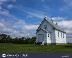 church crosses white country church with three steeples and crosses on the