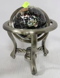 ornamental globe with metal minerals and gemstones
