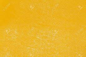 colors close to yellow close up yellow color off set printing paper texture stock photo