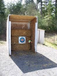 backyard archery set deff having a target gun range on the backyard along with a