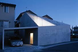 modern concrete house built on a budget and featuring an irregular