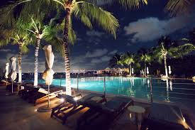 hawaiian coconut neon pool at night miami