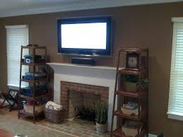 where to put tv tv above fireplace where to put cable box and demonstrate how to