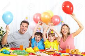 happy family and children celebrating birthday