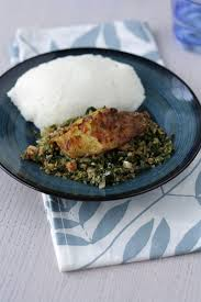 cup cuisine greens in peanut sauce and griddled tilapia fish zambian africa