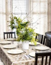 dining room centerpieces with candles window glass yellow napkins