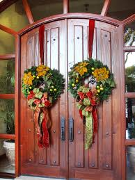 green double christmas wreath design for front door with red gold