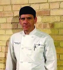 jeff kitchen behind the kitchen door with bar divani executive chef baird