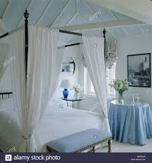 Four Poster Bed Curtains Drapes Simple Four Poster Bed With White Drapes In White Bedroom With