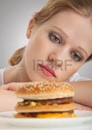 unhealthy eating junk food concept woman looking at big