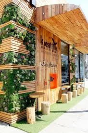 best 25 store front design ideas on pinterest store signs kreation juice shopfront timber greenery shop front designjuice