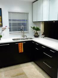 marble countertops black and white kitchen cabinets lighting