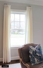 relaxed roman shades and drapes in living room relaxed roman shades and drapes in living room shown in off white linen