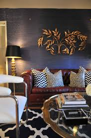 coffee table blue grasscloth wallpaper wall sculpture chevron