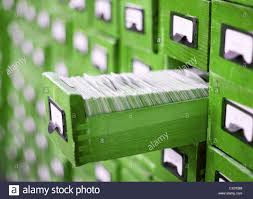 card catalog or cabinet with opened drawer and files stock photo