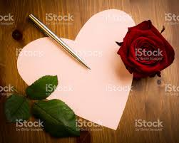 heart shaped writing paper valentine love heart shaped note with pen and rose stock photo valentine love heart shaped note with pen and rose royalty free stock photo