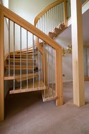 floating staircase design using wooden handle railing and iron
