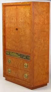 mastercraft amboyna burl and acid etched brass wardrobe cabinet at