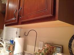 how to paint unfinished cabinets help does the bottom just need to be painted hometalk