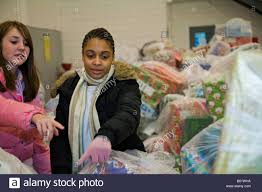 volunteers sort christmas gifts for children in foster care stock