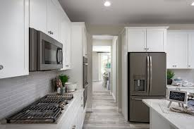 white kitchen cabinets with black slate appliances slate appliances lend contrast to a white kitchen raleigh