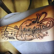 picture of musical and anatomical heartbeat tattoo