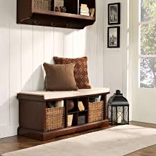 brown wooden freestanding cushioned entry storage bench and wall
