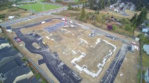 puyallup retirement residence w n development stem walls and slab on grade also part of the project will be install porches for every ground floor living unit and two detached garage units