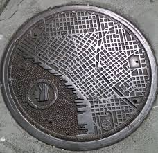 Downtown Seattle Map by Manhole Cover In Seattle Bearing A Map Of The City Pics