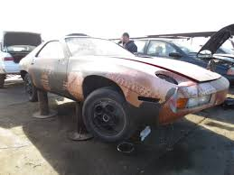 auto junkyard germany junkyard find 1985 porsche 928 weird movie car edition the