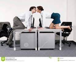 business office desk furniture business couple kissing over desks in office stock photo image of