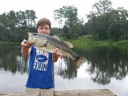 luke baggett with a huge bass caught coastal angler u0026 the angler