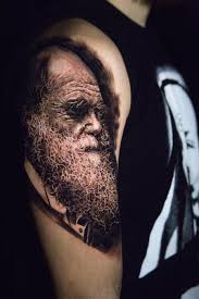black and grey darwin portrait tattoo by carlos ortiz tattoonow
