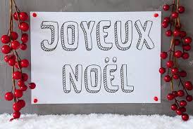 label snow decoration joyeux noel means merry stock