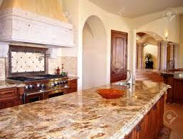 view of kitchen with granite counters large island stock photo