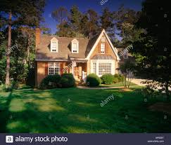 two story houses brick two story house with shutters a large lawn and a