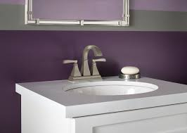 white single bathroom sink with purple painted walls and brushed