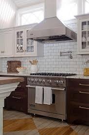 kitchen backsplash with light brown cabinets kitchen with viking and range transitional kitchen