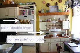 painted hutch with beadboard wallpaper
