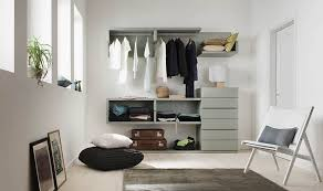small closet organizing set before floor pillows with folding