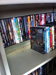 dvd storage a cheap way to double your dvd shelving space i