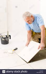 How To Lay Vinyl Flooring Tile Tiling Classes Installing Tile Flooring Laying Ceramic Tile