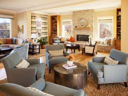 this spacious living room is divided into several sitting areas