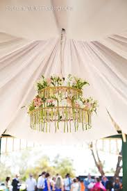 test tube chandelier with fresh flowers ceremony flowers and